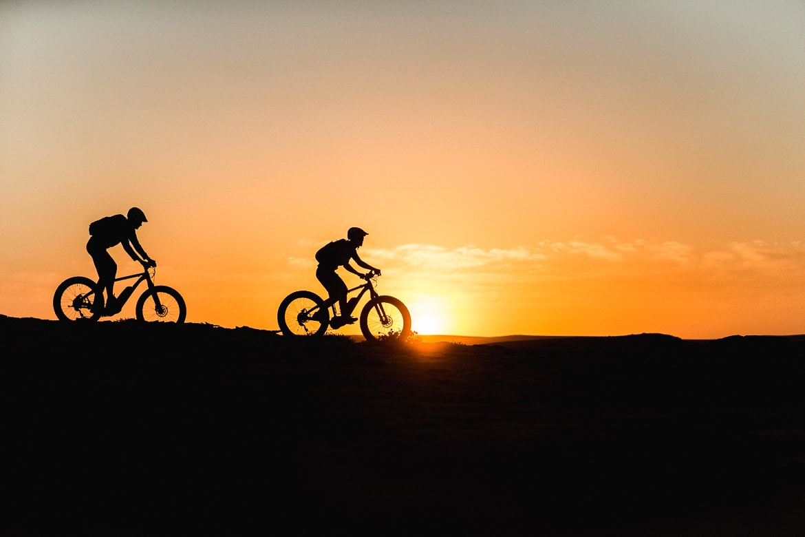 Riding at sunrise on a E-MTB safari of Namibia
