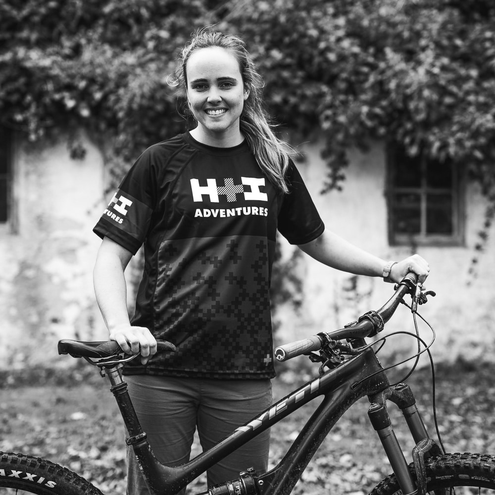 A black and white portrait of a local Scotland mountain bike guide Ella Wright
