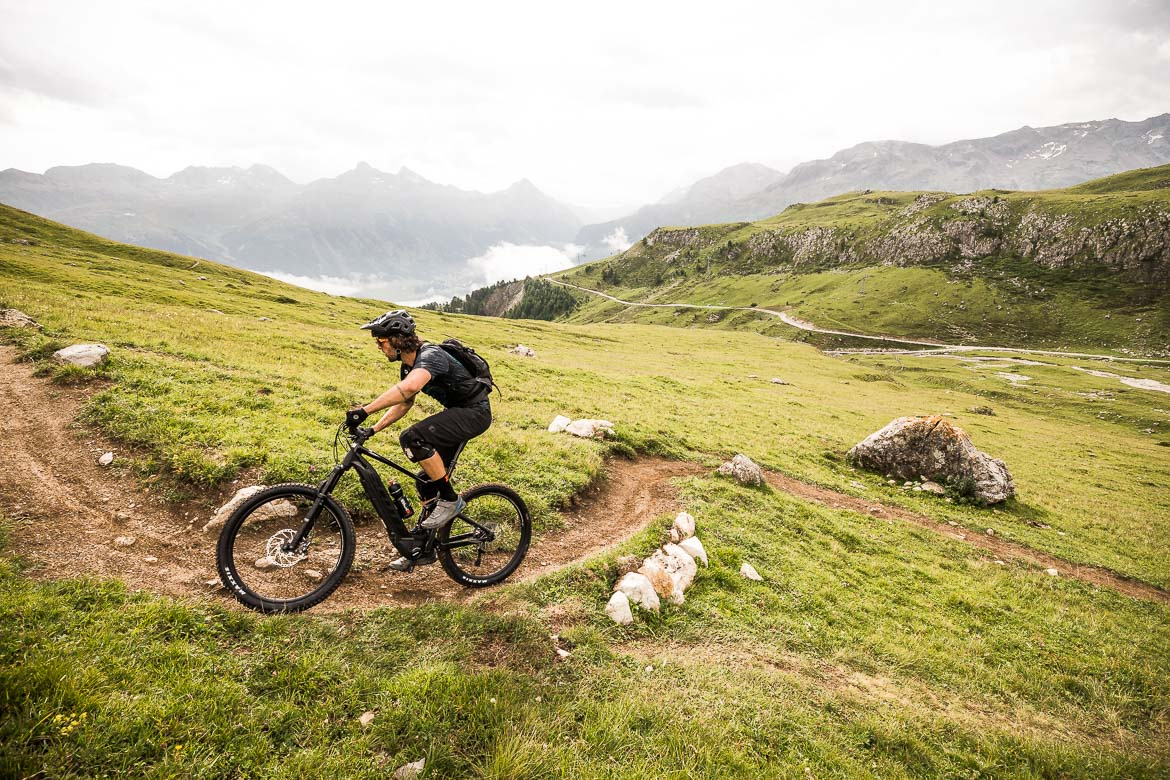 Climbing away from the gondola during an at home with local Swiss guide Dave Spielmann on a E-MTB tour in Switzerland