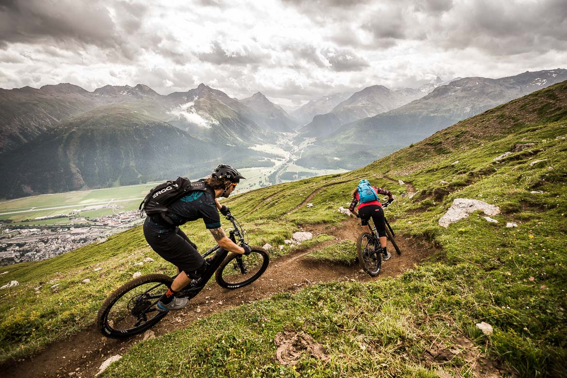 Shredding back towards the valley floor on an at home with local Swiss guide Dave Spielmann on a E-MTB tour in Switzerland
