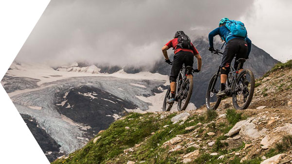 Pedalling towards the Bernina range during a at home with local Swiss guide Dave Spielmann on a E-MTB tour in Switzerland