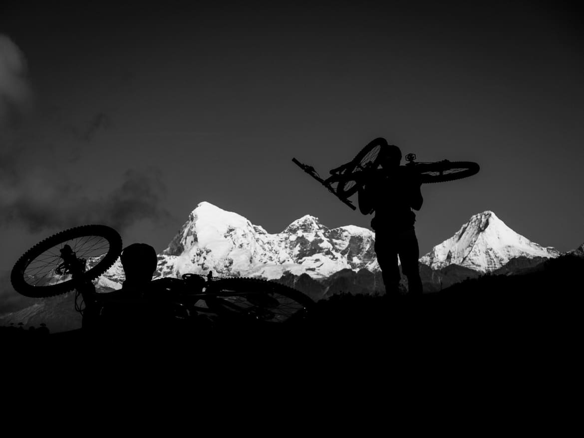 Earning those descents whilst mountain biking in Bhutan