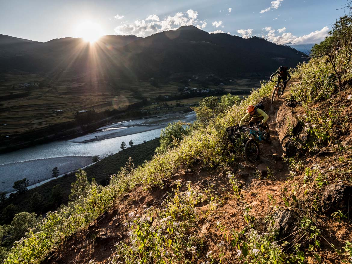 Descending above a river whilst mountain biking in Bhutan